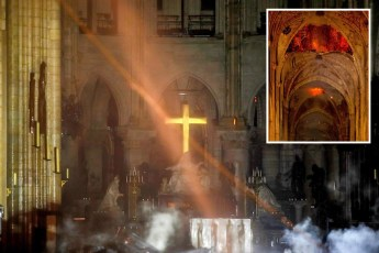Notre-Dame's-golden-altar-cross-glistens-in-the-gloom-as